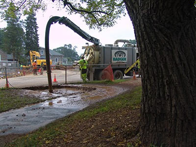 Here you can see hydrovac excavation uses pressurized water to break up the soil cover. photo credit: R. Robert
