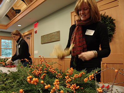 Attendee building a wreath