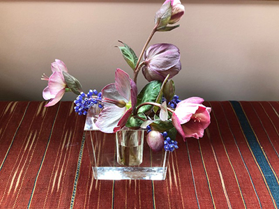 Clear vase with purple blooms