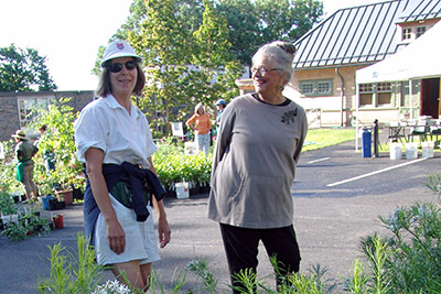 Volunteers Anne Papa and Eve Thryum pause for smile at the 2010 Members Plant Exchange and Sale. photo credit: R. Robert