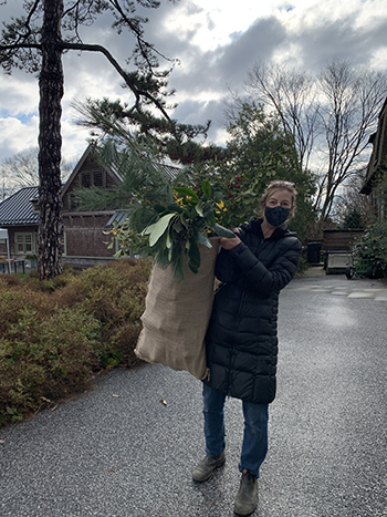 women holding a bag of greens
